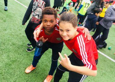 Two kids on soccer field